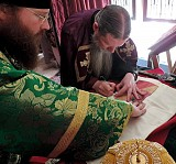Signing the monastery's Antimins